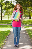 Gorgeous smiling student carrying notebooks