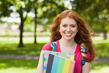 Gorgeous smiling student holding notebooks