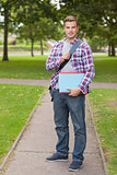 Handsome happy student holding notebook and folder