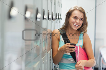 Cheerful pretty student texting