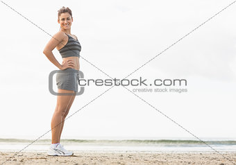 Beautiful slender woman posing with her hands on hips