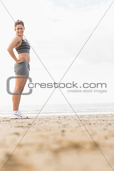 Attractive slender woman posing on the beach