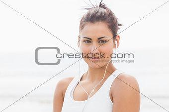 Cute young woman posing looking at camera