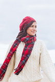 Pretty woman in stylish warm clothing looking away