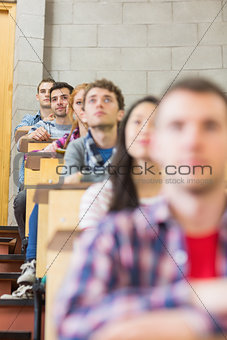 Close up of young students sitting in classroom