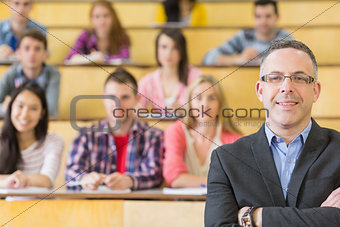 Elegant teacher with students sitting at lecture hall