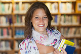 Close up of a smiling female student in the library