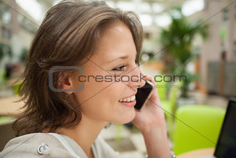 Close up side view of a woman using mobile phone