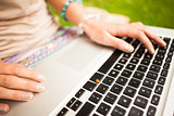 Detail shot of a woman using laptop