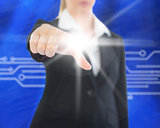 Composite image of businesswoman pointing on screen