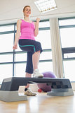 Young woman at aerobics class in gym