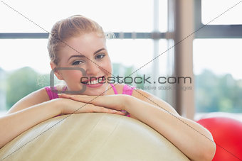 Close up of a beautiful woman leaning on exercise ball
