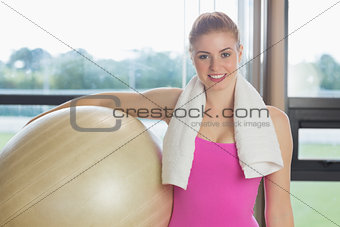 Fit beautiful woman carrying exercise ball