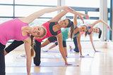 Women stretching on mats at yoga class