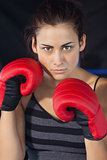 Close up of a beautiful woman in red boxing gloves