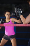 Female boxer focused on her training