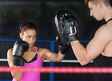 Determined female boxer focused on her training