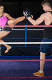 Female boxer practicing an air kick