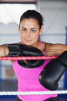 Portrait of a beautiful woman in black boxing gloves