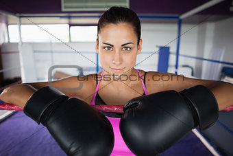 Close up of a beautiful woman in black boxing gloves