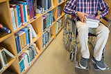 Low section of a man in wheelchair in the library