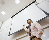Male teacher with projection screen in the lecture hall