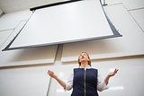 Female teacher with projection screen in the lecture hall