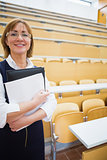 Elegant female teacher in lecture hall