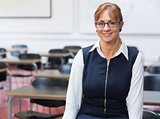 Smiling female teacher in the class room