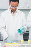 Male researcher experimenting in the lab