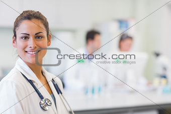 Close up portrait of confident doctor at medical office