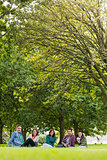 College students sitting in park