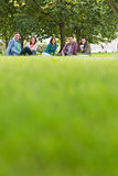 College students sitting on grass in park