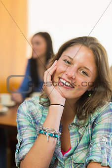 Close up portrait of a smiling female at  coffee shop
