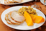 Sliced turkey with squash and dressing