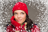 Mixed Race Woman Wearing Winter Hat and Gloves Enjoys Snowfall