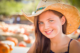Preteen Girl Portrait Wearing Cowboy Hat at Pumpkin Patch