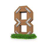 Wooden number eight in the grass