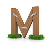 Wooden letter M in the grass