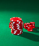 Red poker chips and red dice