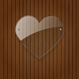 Vector glass heart over wooden background.