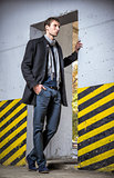 Fashion shot: handsome young man wearing jeans and coat