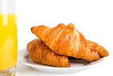Croissants and glass of orange juice