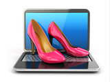 Online shopping. High heel shoes on laptop.