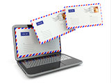 E-mail concept. Laptop and envelopes