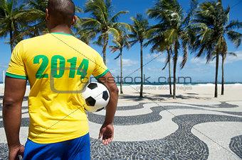 Brazilian soccer football player wears 2014 shirt Rio