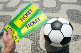 Soccer fan holds tickets above football in Brazil