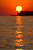 Sunset over lighthouse in Zadar