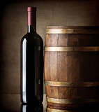 Bottle and wooden barrel