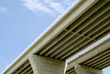 Underside of highway bridges on blue sky